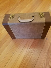 gray and brown suitcase