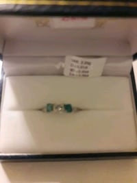 14kt white gold ring diamond&2emeralds with aprais