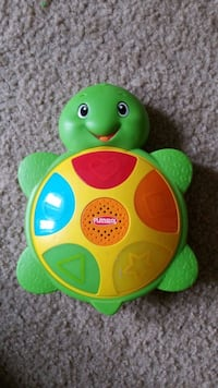 green and yellow plastic toy