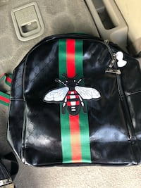 black and green Gucci backpack 28 km