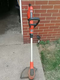 red, black, and red electric string trimmer