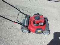 red and black push mower Lubbock, 79423