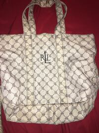 white and black Gucci backpack