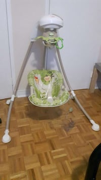 baby's white and green cradle 'n swing