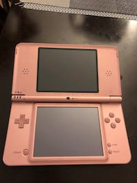 white Nintendo DS with game cartridge New York, 11355