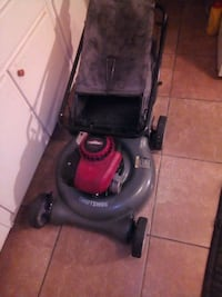 black and red lawnmower Bakersfield, 93304