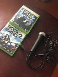 Rock band 1 and 2 with microphone. Sold as set. Sacramento, 95823