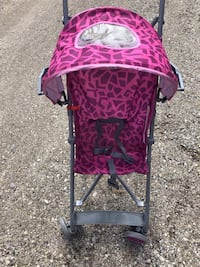 Baby's pink and black stroller Wasaga Beach, L9Z 2L7