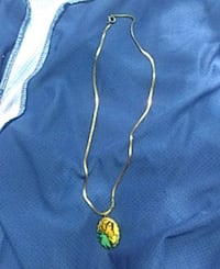 gold-colored necklace with green gemstone pendant Belton, 76513