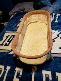 baby's brown and white bassinet Mississauga, L5L 5J8