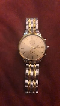 Round silver analog watch with gold link bracelet Bethesda, 20814