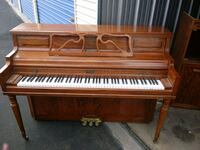 brown and white upright piano Lancaster, 93535