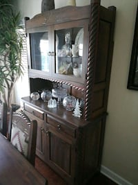 Elegant Hutch with hand carved highlights