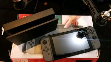 Nintendo switch all black like new sale or trade