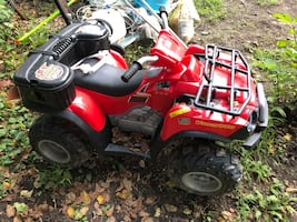 Red and black all-terrain vehicle