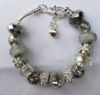 CLEAR/SILVER charm bracelet. 2 for $25 Baltimore, 21224