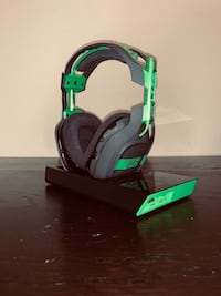 green and black corded headphones Austin
