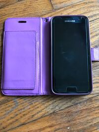 black Samsung android smartphone with purple case Toronto, M1G 3N6