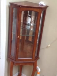 brown wooden framed glass display cabinet 26 mi
