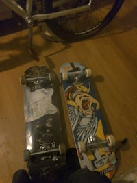 two black and yellow printed skateboards