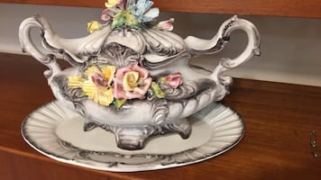 Italian ceramic urn plate decor with ornate details.