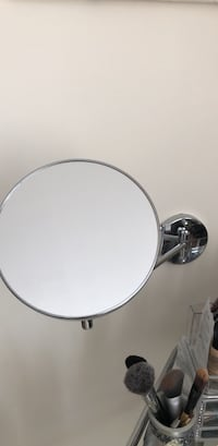 Round silver-colored analog magnifying mirror  New York, 10028
