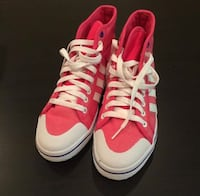 pair of red Adidas high-top sneakers
