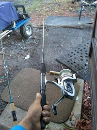 black and gray fishing reel