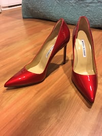 pair of red-and-beige patent leather pointed toe heels
