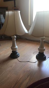 two black wooden base white shade table lamps