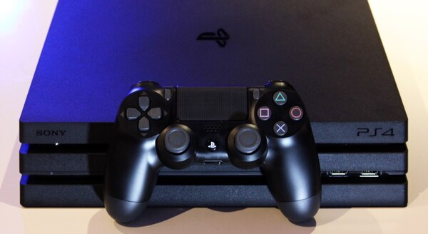 black Sony PS4 game console with controller