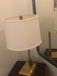 Gold lamp with beige shade.