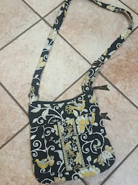 black, yellow and white floral print sling bag