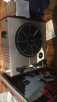 Record player with speaker and albums Waxhaw
