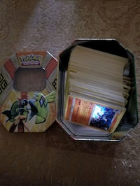 200 Pokemon cards and collector tin.  Whitby, L1P 1A2