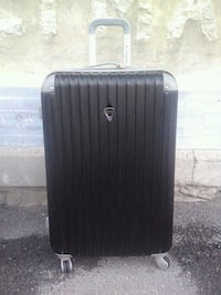 Travelers Club hard shell suitcase