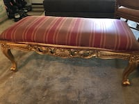 gold-colored wooden base red padded bench