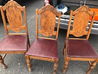 3 wooden framed brown padded chairs 22 km