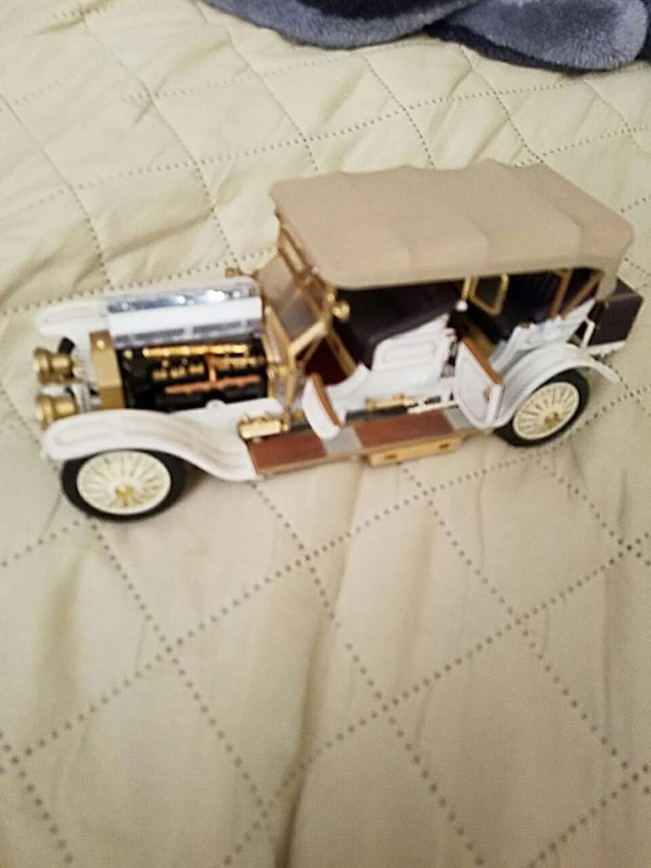 white and brown classic car scale model