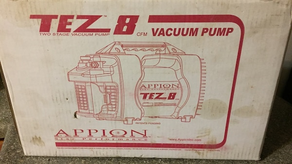 Brand new two stage vacuum pump in box never opened!