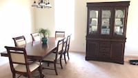 Dining room table, chairs, and lighted China cabinet Holly Springs, 27540
