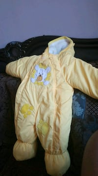 baby's yellow and white footie pajama