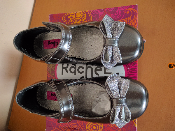 pair of metallic Rachel shoes with bowaccent  Collegeville