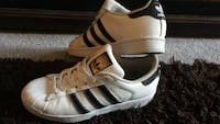pair of white-and-black Adidas Superstar sneakers size 5