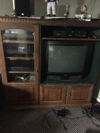 Entertainment center for sale. Must go. Components not included, but the tv is yours if you want it. Holland, 49423