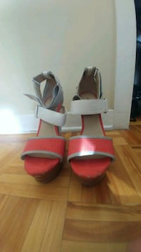 pair of women's red-and-grey open-toe stilettos