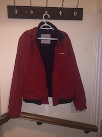 Large red Hilfiger jacket. Includes a hoodie which can be tucked in. Richmond Hill, L4S 0G3