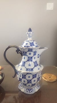 white and blue floral ceramic pitcher