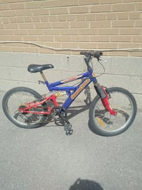 blue and red full-suspension bike Toronto, M9W 2A3