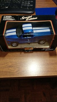 blue and white pickup truck toy in b ox Vaughan, L4J 7Y3